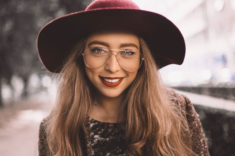 Alice Hat Young Adult Portrait Real People Young Women Lifestyles One Person Beautiful Woman Looking At Camera Focus On Foreground Eyeglasses  Smiling Front View Headshot Happiness Cheerful Outdoors Long Hair Leisure Activity Fashion EyeEmNewHere