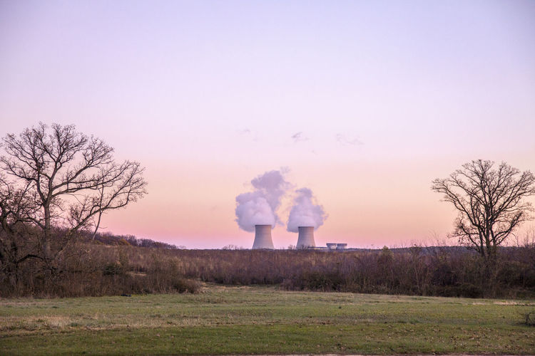 MidWest Nucler Bare Tree Beauty In Nature Clear Sky Day Emitting Factory Field Industry Landscape Nature No People Nuclear Power Plant Nuclear Power Station Outdoors Sky Smoke - Physical Structure Smoke Stack Tree