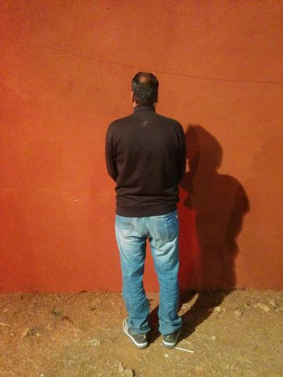 Man Standing Rear View One Person One Man Only Full Length Only Men Standing People Adult Adults Only Men Day Indoors  Human Back Powder Paint Holi Politics And Government Single Man Man Standing In Front Of Wall
