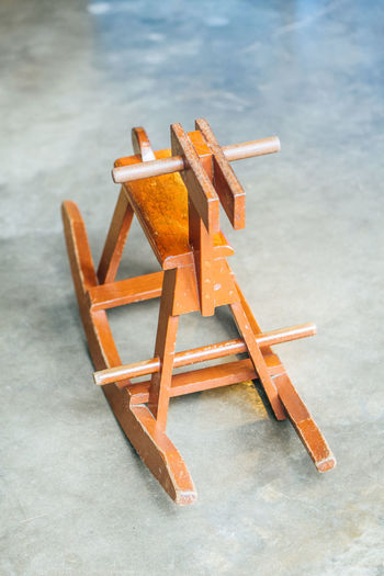 High angle view of chair on table