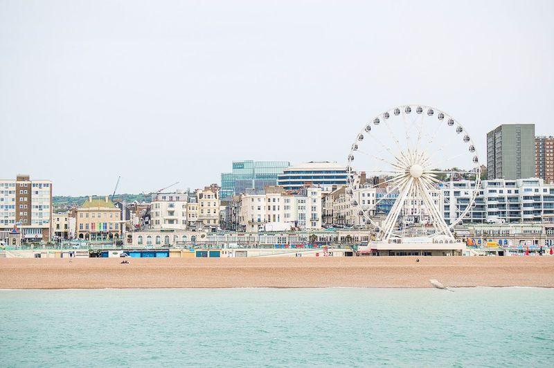 Ferris Wheel At Beach Against Sky
