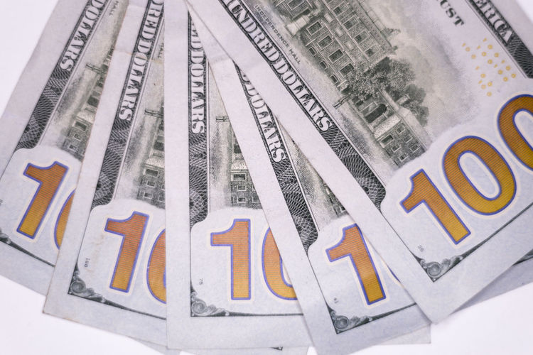 Backside of one hundred dollar bills fanned out 100 Dollar Bills American Benjamin Franklin Bills Bitcoin Buying Cash Compensation Currency Digital Fraud Management One Hundred Pay Payday Payment Salary Selling Tax Wages Wallet Wealth