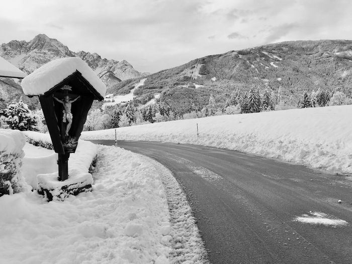 Road against mountains during winter