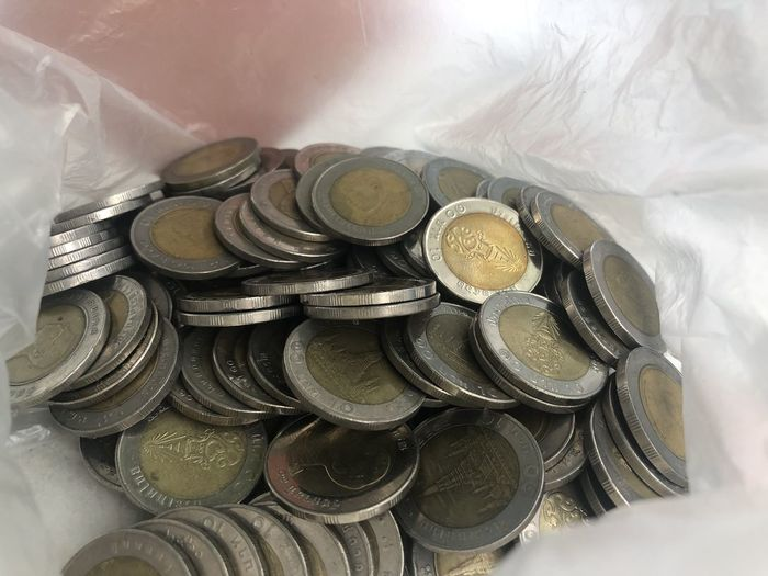 High angle view of coins