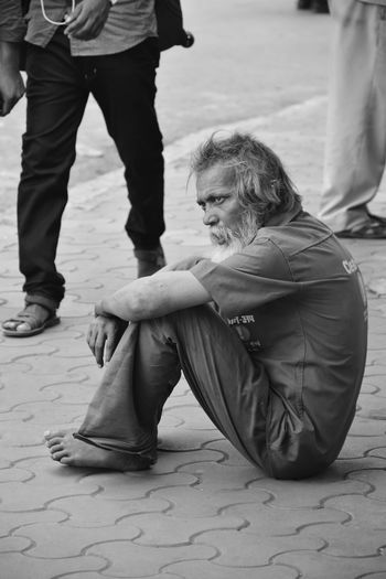 INFIRM - I Old Man Man Male Photography Alone Lonely Loneliness Sad Sadness Hair Sitting Beggar Streetphotography Poor  EyeEm Best Shots EyeEmNewHere Old City Blackandwhite Adult Women People Men Social Issues Lifestyles Human Body Part Sitting Emotion Archival Clothing