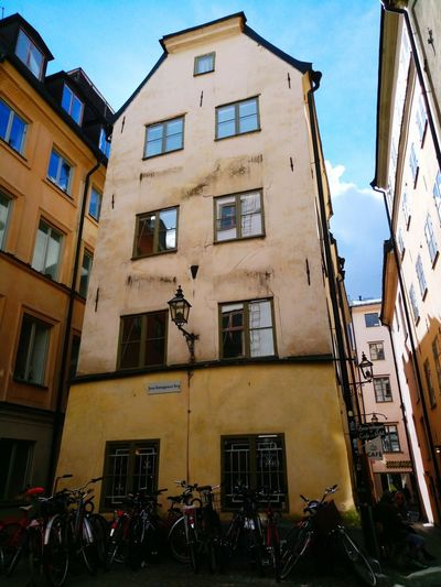 Low Angle View City Day Outdoors Building Exterior Building Exterior Building Exterior Architecture Bicycles Bicycle Rack No People Stockholm Sweden Backview Historical Building Travel Destinations Built Structure History Sky