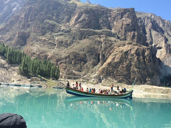 Attabad Lake Disaster Road Block Glacier Avalaunch Towns Underneath Beauty And The Beast Most Beautiful Disaster Lake Pakistan Travel Traveller Tour Nature Water Blue Peaceful Boat Ride Boat People Happy Serene Reflection EyeEmNewHere Miles Away