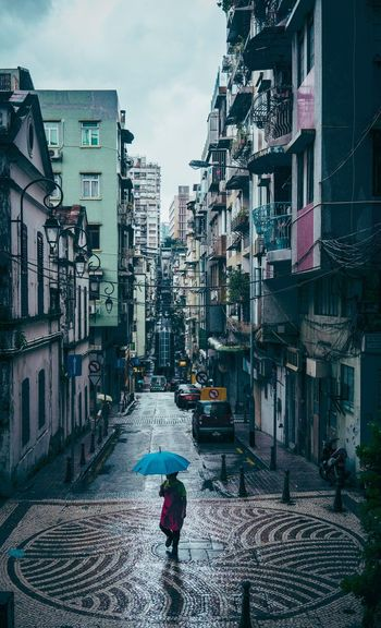 www.instagram.com/steveroe_ Street Macao  Umbrella Building Exterior Built Structure Architecture City Building Real People Lifestyles Street Day Women Leisure Activity Walking Rain Outdoors Nature Sky