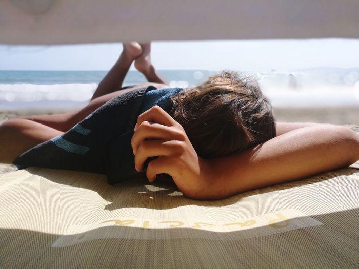 Woman Lying Down At Beach