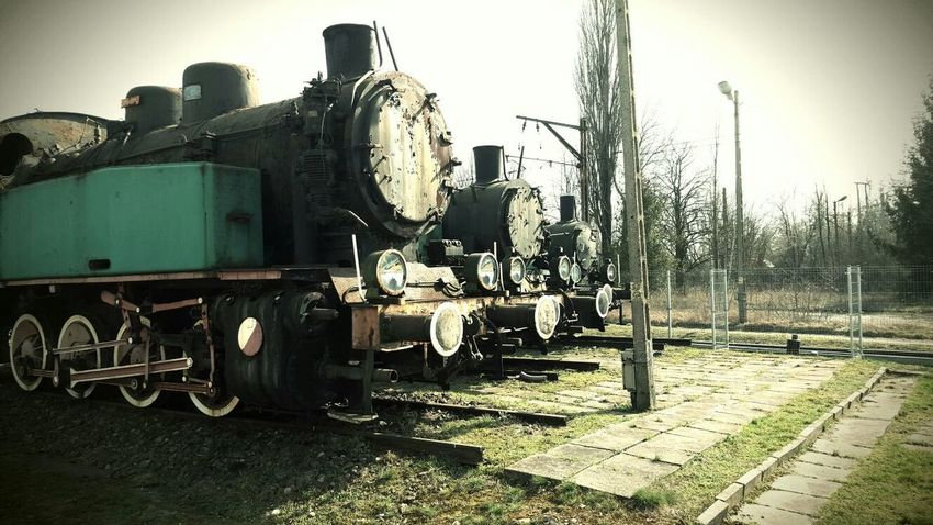 Three brothers of machinery, 2 polish and one localmotive. Old Machinery Train Trains Localmotive Old Metal Rusty Eyeem Vintage Old Train Eyeemphotography Old Engine Rust EyeEm Best Edits Pastel Power Row Of Lights Train Tracks EyeEm Best Shots Eyeem Vintage Collection