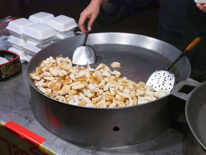 Cropped image of hand preparing squid