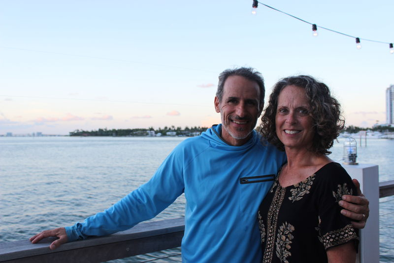 Adult Bonding Cheerful Couple - Relationship Day Happiness Heterosexual Couple Looking At Camera Love Mature Adult Mature Couple Mature Men Mature Women Men Outdoors Portrait Real People Sea Sky Smiling Sunset Togetherness Two People Vacations Water Connected By Travel