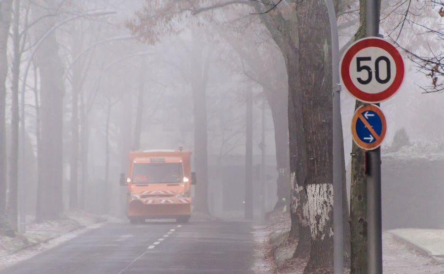 City Life Cold Communication Day Dust Fog Foog Foogy Misty Morning Nature No People Outdoors Road Road Sign Snow Street Traffic Tree Urban Exploration Winter Zehlendorf