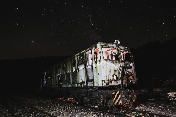 Abandoned train against sky at night