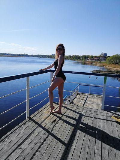 Full length of woman in sea against sky
