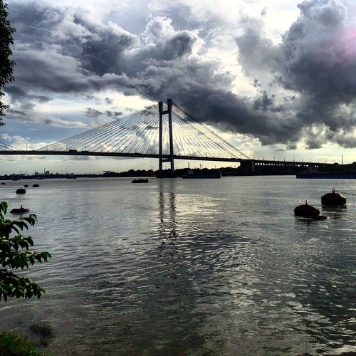Clouds as a Background to the bridge, Architecture Beauty In Nature Bridge Bridge - Man Made Structure Built Structure Cloud Cloud - Sky Cloudy Connection Day Engineering Nature No People Outdoors Overcast Rippled River Scenics Sky Suspension Bridge Tourism Tranquil Scene Tranquility Travel Destinations Water