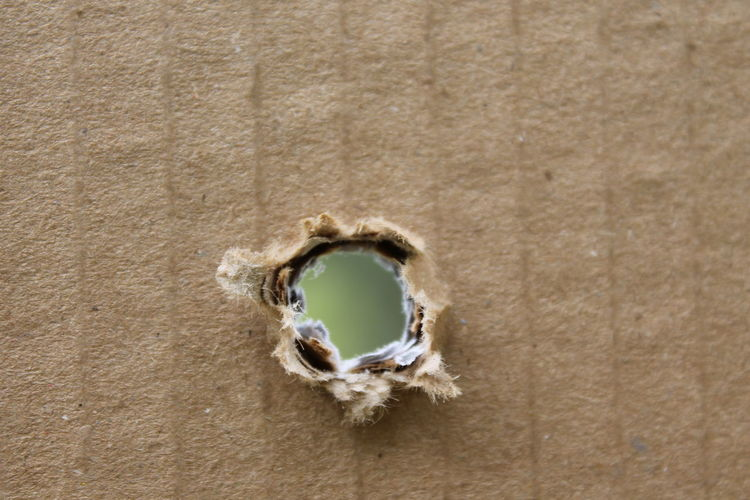 Close-Up Of Target Board With Bullet Hole