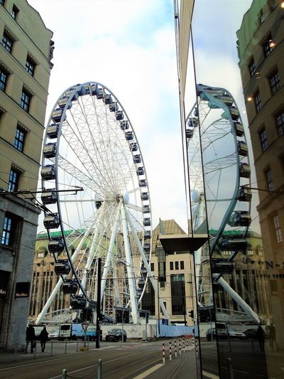 Amusement Park Architecture Building Exterior City Cloud - Sky Day Ferris Wheel Lightand Reflection No People Outdoors Sky Travel Destinations