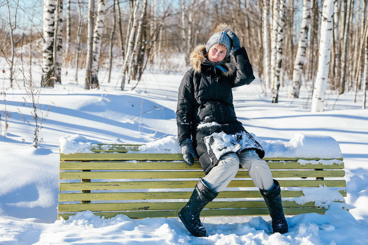 Full length of woman on snow field