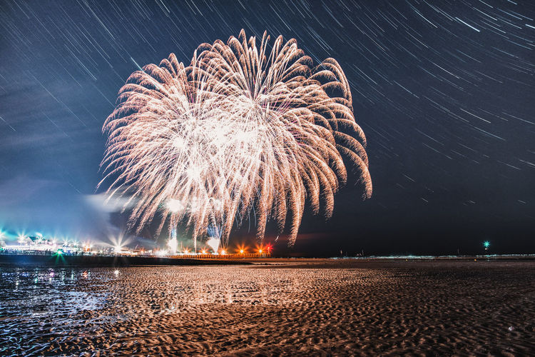 These fireworks were part of some kind of festival spanning across multiple beach towns in Normandy, France. The Traveler - 2018 EyeEm Awards Arts Culture And Entertainment Blurred Motion Celebration Event Exploding Firework Firework - Man Made Object Firework Display Glowing Illuminated Land Light Light Trail Long Exposure Motion Nature Night No People Outdoors Sky Smoke - Physical Structure Sparks Water The Great Outdoors - 2018 EyeEm Awards