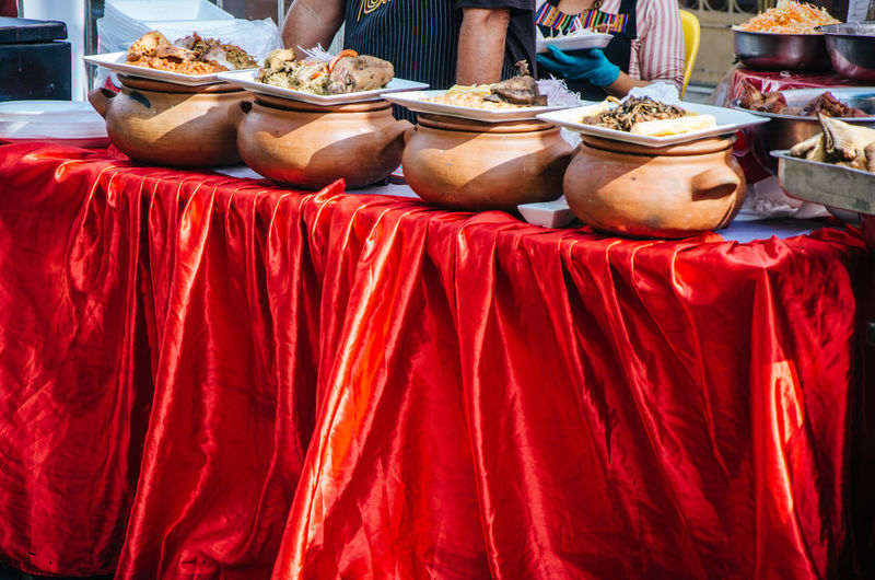 Clay pots with traditional Peruvian food at a gastronomic fair Couscous Cuisine Dinner Dürüm Homemade Lamb Lunch Meal Service Tajine Bowl Clay Cooked Cream Crock Food Portion Pot Serving Stew Stewed Tabbouleh Traditional Veal Vertical