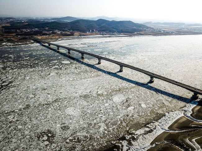 Drift ice of Choji Bridge in Kanghwa island, Korea. Choji Bridge Sea Ice WinterSea Drone Photography Drone Shot Choji Bridge Korea Winter Ganghwa Island Water Day Land Tranquility Sky High Angle View Tranquil Scene No People Scenics - Nature Outdoors Sea Beauty In Nature