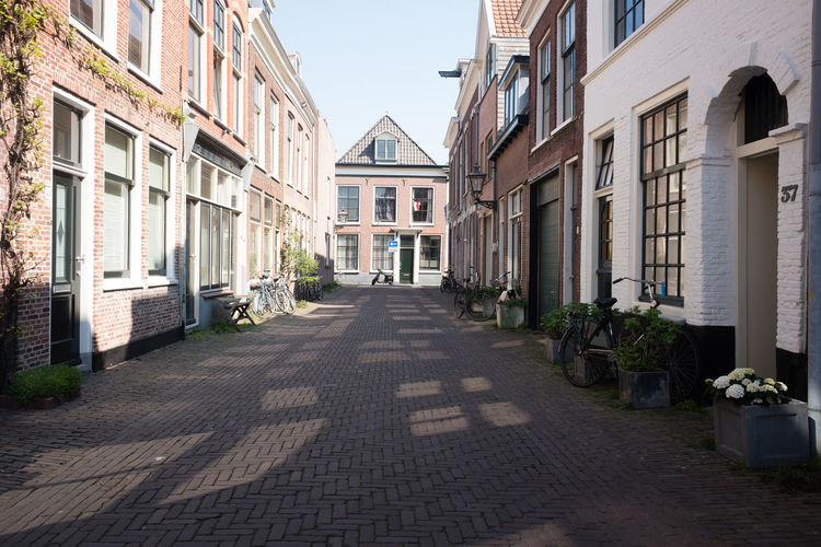 Street in Leiden Architecture Building Exterior Built Structure Building Direction The Way Forward Street City Residential District No People Nature House Day Plant Diminishing Perspective Transportation Window Empty Footpath Outdoors Row House Long Alley