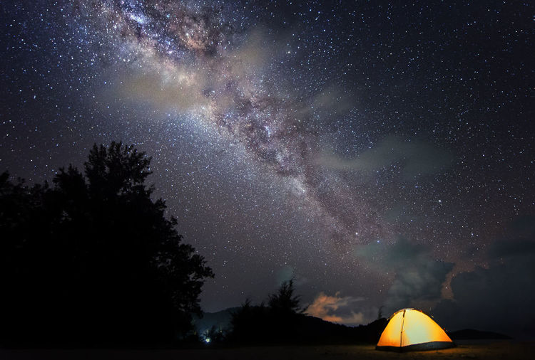 camping tent under the bright milkyway Astronomy Beauty In Nature Constellation Galaxy Illuminated Milky Way Nature Night No People Outdoors Sky Space Space Exploration Star - Space Starry Tent Tree