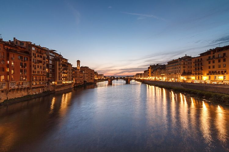 Ponte Vecchio Bridge Over Arno River At Dusk