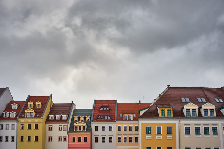 Houses Against Cloudy Sky