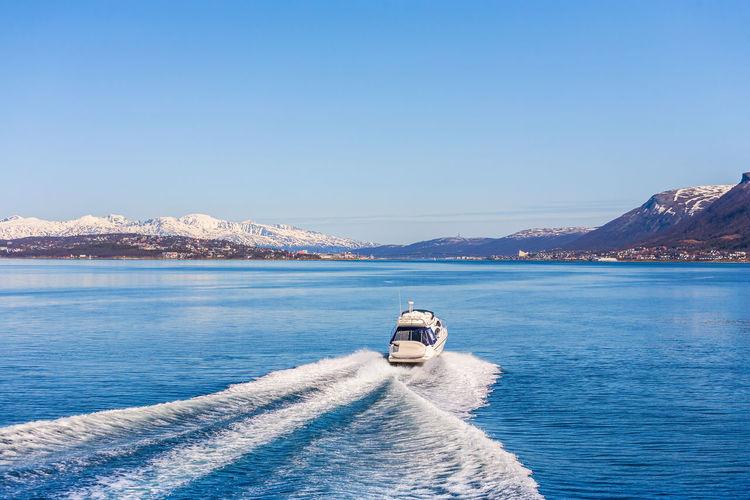 Motor boat heading to tromso in norway