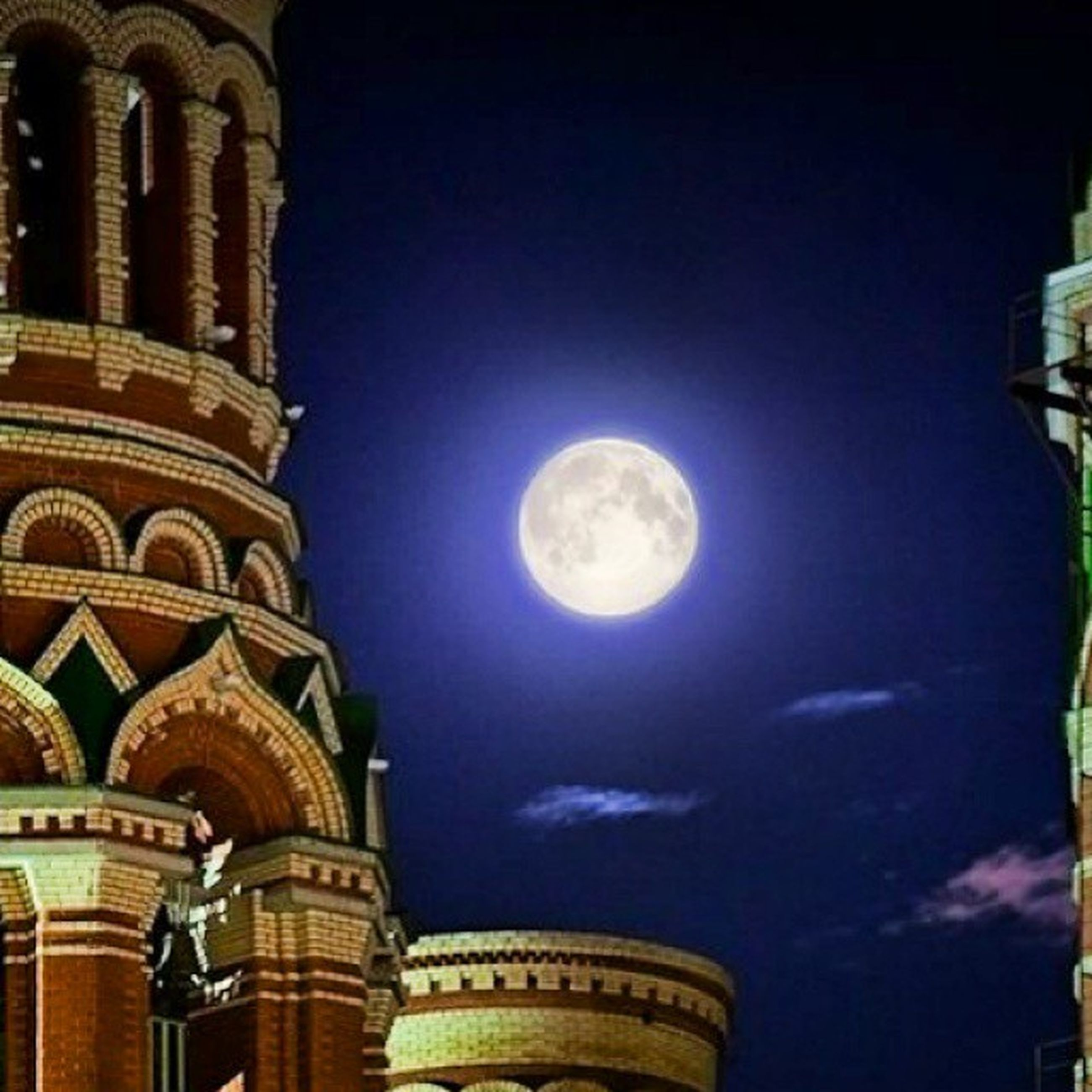 architecture, built structure, building exterior, low angle view, sky, moon, arch, night, building, history, illuminated, city, outdoors, no people, high section, blue, cloud - sky, dome, circle, full moon