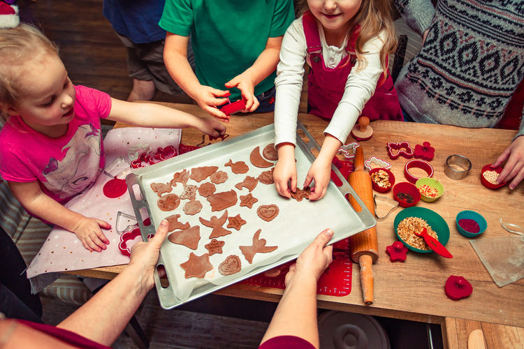 High angle view of children making cookies