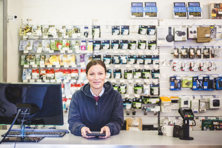 Portrait of a smiling young woman in store