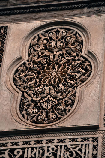 Low angle view of ornate carving on building