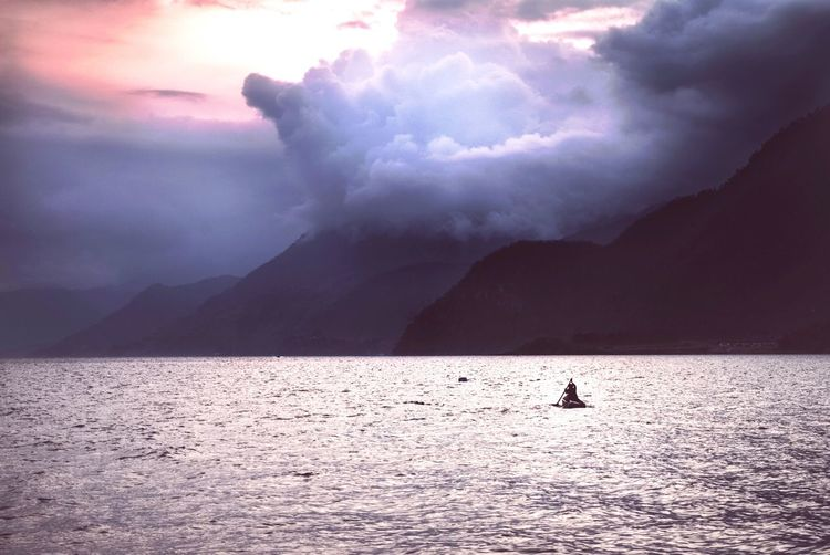 Silhouette Of A Man Paddling