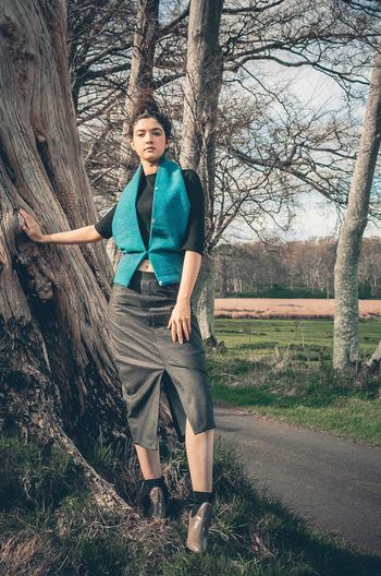 Scotland Tweed Scottish Models Trees Teal One Person Tall Girl Tailoring Betty Spoke Portrait Tree Trunk Standing Only Women Full Length Looking At Camera Outdoors Front View Branch Nature Bare Tree Day Bespoketailoring Made In Scotland Scottish Designers Gillian McBain Photographer