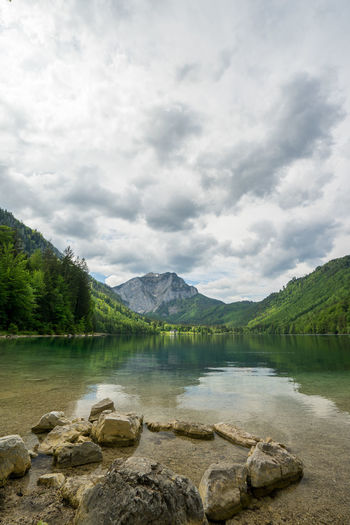 Angeln Austria Bergsee Essen Salzkammergut Urlaubsregion Wandern Österreich Cloud - Sky Sky Lake Scenics - Nature Water Mountain Nature Tree Beauty In Nature Rock Tranquility Day Tranquil Scene Solid No People Plant Non-urban Scene Environment Rock - Object Langbathsee