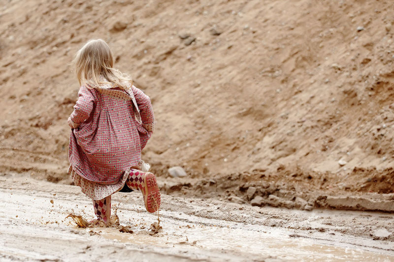 Blond Hair Casual Clothing Child Childhood Clothing Day Females Full Length Girls Hair Hairstyle Land Offspring One Person Outdoors Real People Rear View Women