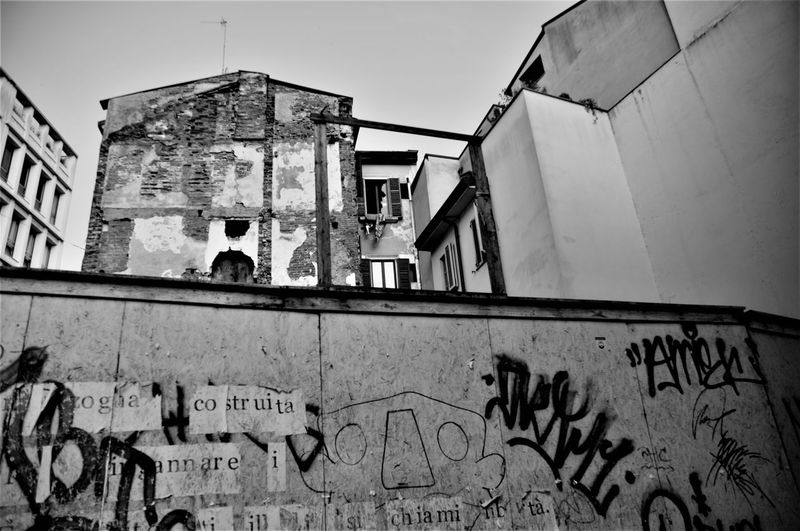 Architecture Building Exterior Built Structure Day Decay Graffiti Graffiti Low Angle View Neighborhood Outdoors Poor  Run-down Suburbia Text