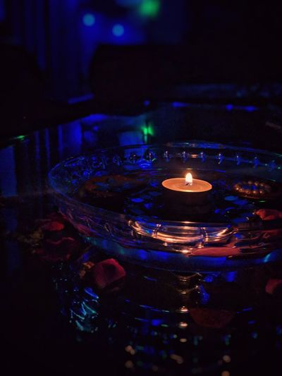Close-up of lit candles in the dark