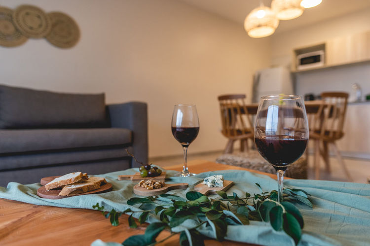 Wine glasses on table at home
