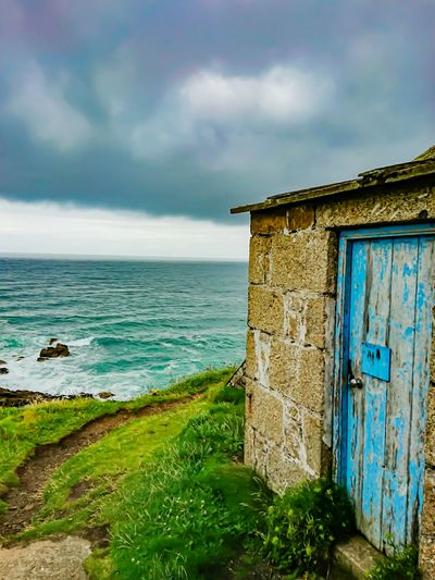 Seascape Sea Beach Cloud - Sky Built Structure Architecture Water Horizon Over Water Outdoors Building Exterior Old-fashioned Grass Nature Sky Vacations No People Day Scenics Landscape Country Life Rural Area Rural Scene Freshness Growth Rural Photography Ocean And Sky