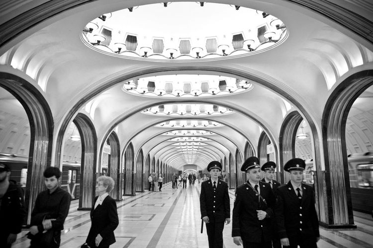 EyeEmNewHere Metro Moscow Moscow Metro Stations My Best Travel Photo Russia Tranquility Arch Architectural Column Architecture Black And White Blackandwhite Mayakovskaya Metro Station Moscow Police Police Force Public Transportation Russian Subway Subway Station Transportation Travel