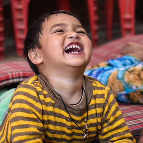 Close-up of boy laughing