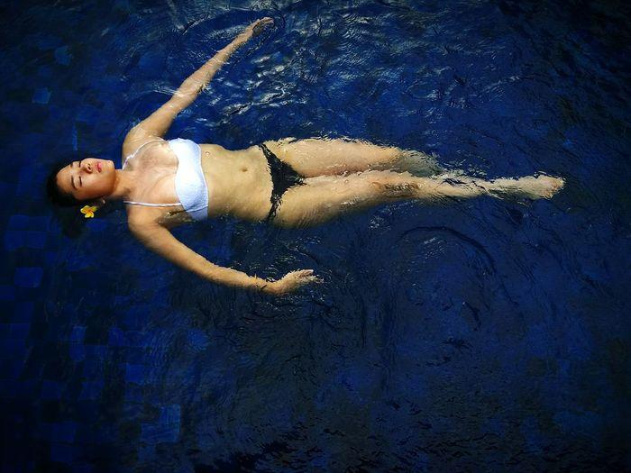 Full Length Of Sensuous Model Wearing Bikini In Swimming Pool
