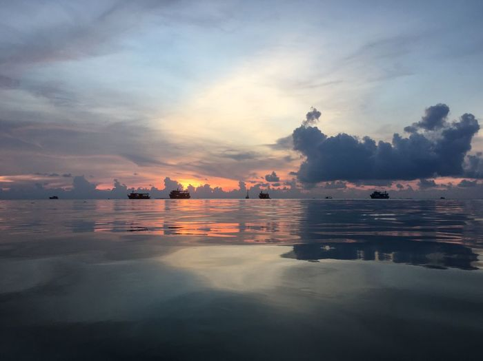 Sunset View Ship Bule Orange Sky Sunset Cloud - Sky Water Sea Sky Tranquility Reflection Outdoors Nautical Vessel Beach Beauty In Nature No People Horizon Over Water