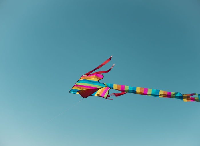 Blue Celebration Clear Sky Copy Space Day Environment Flying Kite Kite - Toy Low Angle View Mid-air Multi Colored Nature No People Outdoors Shape Sky Streamer Sunlight Wind