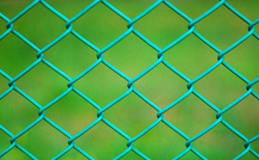 Close-up of chainlink fence at field