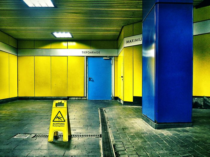 Blue And Yellow Notes From The Underground Wet Floor Closed Door in Bonn